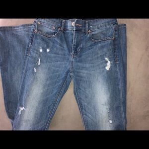 Distressed, barely boot cut jeans